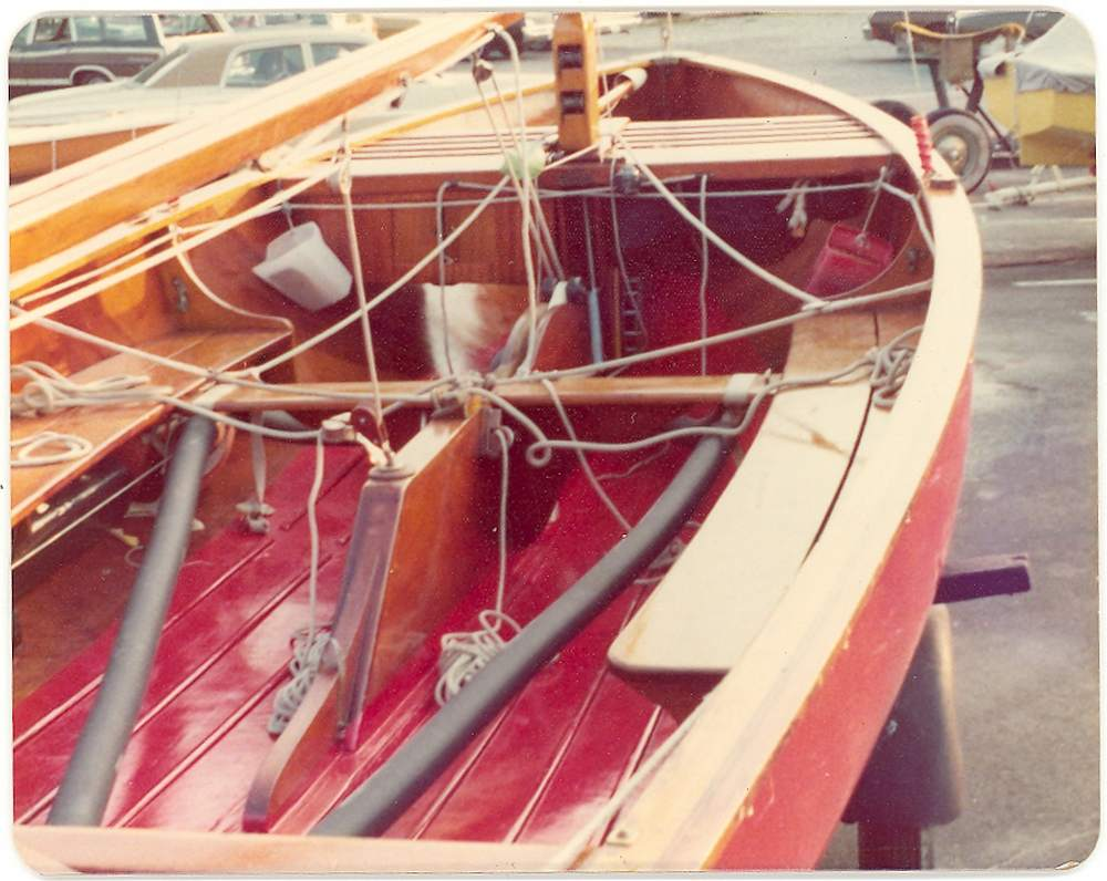 thistle class wooden sailaboat